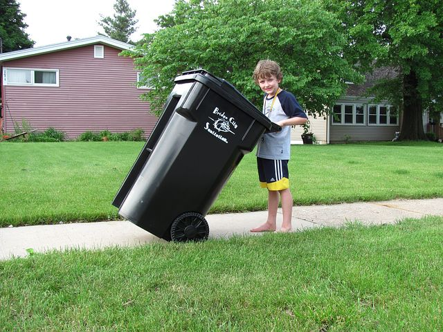 garbage bin and a boy